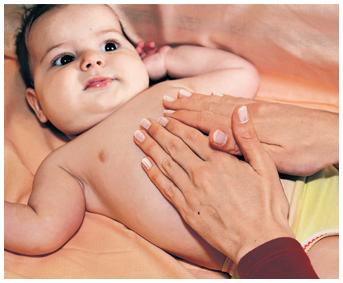 Grčevi kod beba - masaža, Bebicol